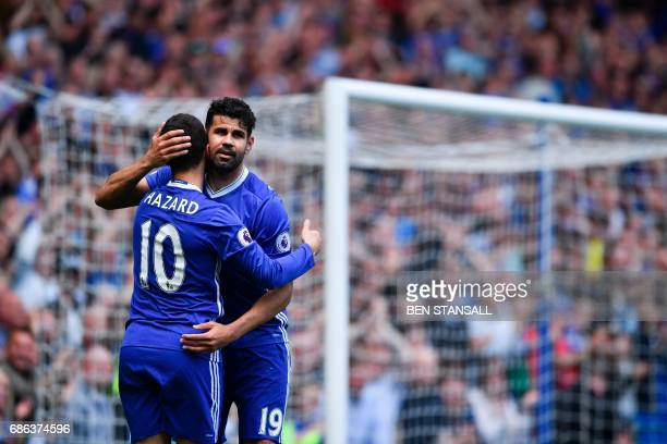 Chelsea's Belgian midfielder Eden Hazard emabraces Chelsea's Brazilianborn Spanish striker Diego Costa after scoring their second goal during the...