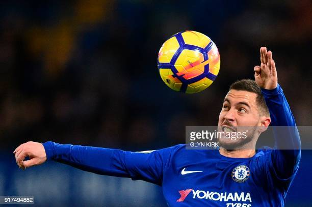 Chelsea's Belgian midfielder Eden Hazard eyes the ball during the English Premier League football match between Chelsea and West Bromwich Albion at...