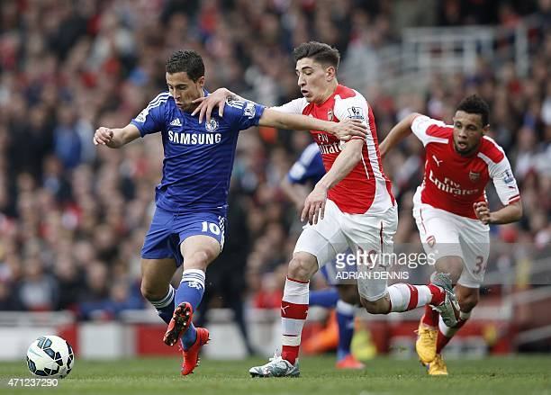 Chelsea's Belgian midfielder Eden Hazard holds off Arsenal's Spanish defender Hector Bellerin during the English Premier League football match...