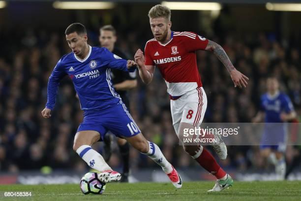Chelsea's Belgian midfielder Eden Hazard holds off Middlesbrough's English midfielder Adam Clayton during the English Premier League football match...