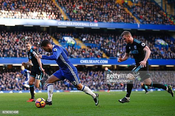 Chelsea's Belgian midfielder Eden Hazard is chased by West Bromwich Albion's Scottish midfielder Darren Fletcher and West Bromwich Albion's Northern...