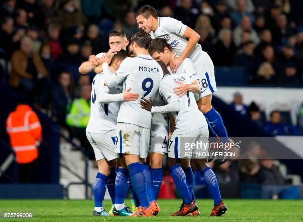 Chelsea's Belgian midfielder Eden Hazard is mobbed by teammates after scoring his team's fourth goal during the English Premier League football match...
