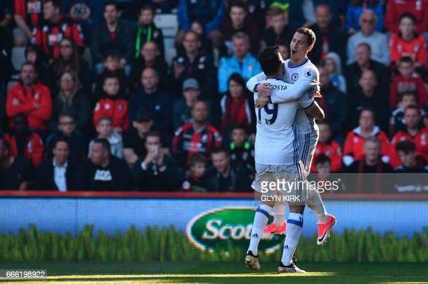 Chelsea's Belgian midfielder Eden Hazard jumps into the arms of Chelsea's Brazilianborn Spanish striker Diego Costa as he celebrates scoring their...