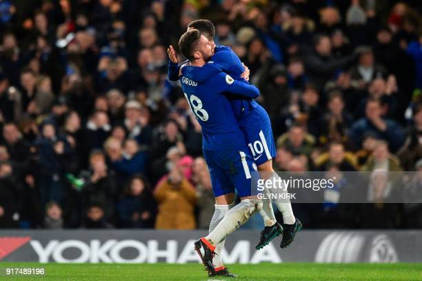 Chelsea's Belgian midfielder Eden Hazard jumps into the arms of Chelsea's French attacker Olivier Giroud as he celebrates scoring the opening goal...