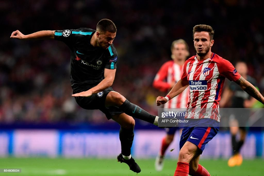 Chelsea's Belgian midfielder Eden Hazard (L) kicks to score during the UEFA Champions League Group C football match Club Atletico de Madrid vs Chelsea FC at the Metropolitan stadium in Madrid on September 27, 2017. /