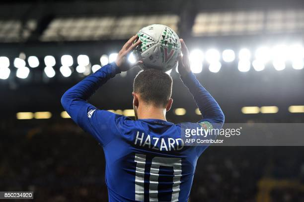 Chelsea's Belgian midfielder Eden Hazard pretends to take a throwin during the English League Cup third round football match between Chelsea and...