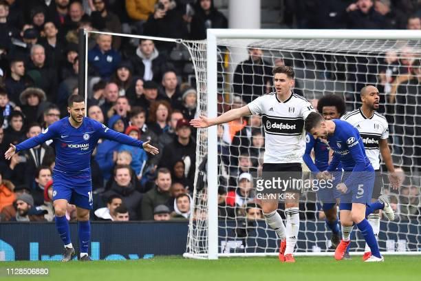 Chelsea's Belgian midfielder Eden Hazard reacts as Chelsea's Italian midfielder Jorginho starts to celebrate scoring their second goal during the...