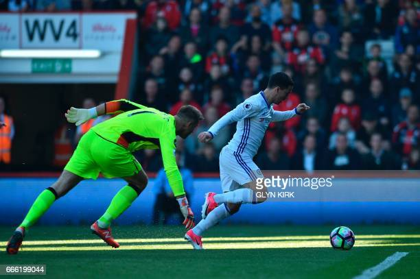 Chelsea's Belgian midfielder Eden Hazard rounds Bournemouth's Polish goalkeeper Artur Boruc to score their second goal during the English Premier...