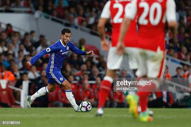 Chelsea's Belgian midfielder Eden Hazard runs with the ball during the English Premier League football match between Arsenal and Chelsea at The...