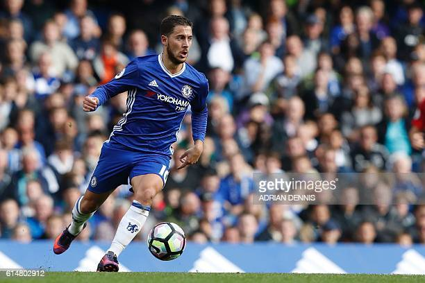 Chelsea's Belgian midfielder Eden Hazard runs with the ball during the English Premier League football match between Chelsea and Leicester City at...