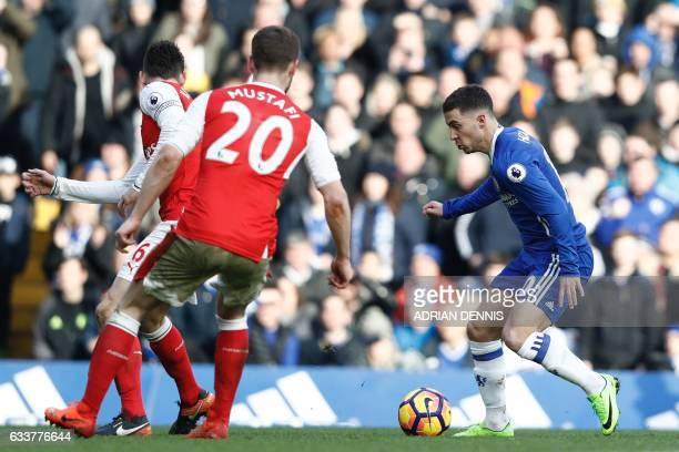 Chelsea's Belgian midfielder Eden Hazard runs with the ball during the English Premier League football match between Chelsea and Arsenal at Stamford...