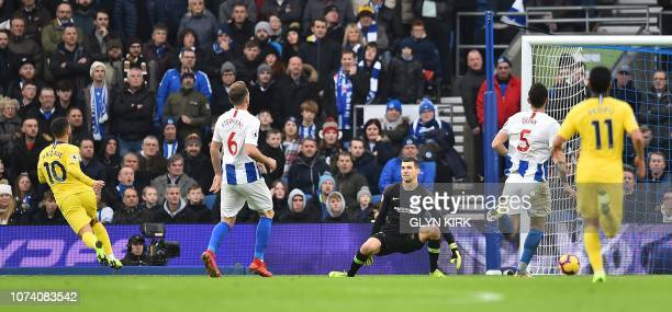 Chelsea's Belgian midfielder Eden Hazard scores his team's second goal during the English Premier League football match between Brighton and Hove...