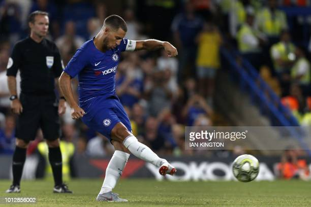 Chelsea's Belgian midfielder Eden Hazard scores the winning penalty at the penalty shootout during the International Champions Cup football match...