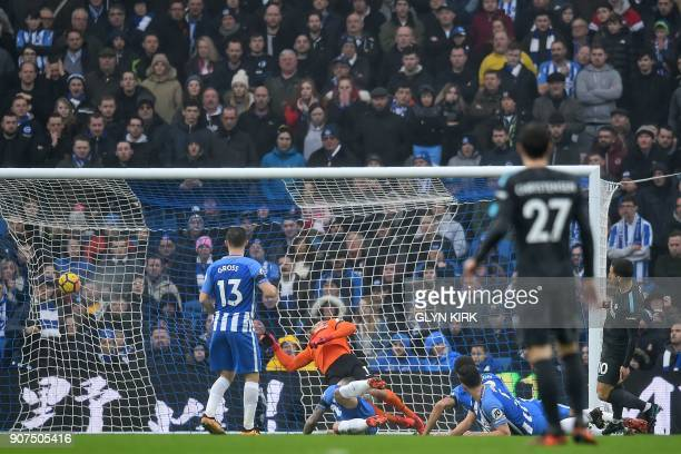 Chelsea's Belgian midfielder Eden Hazard sees his shot hit the back of the net as he opens the scoring in the English Premier League football match...