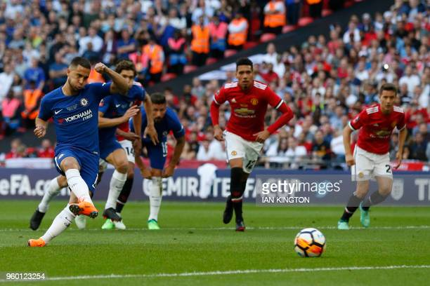 Chelsea's Belgian midfielder Eden Hazard shoots and scores from the penalty spot during the English FA Cup final football match between Chelsea and...