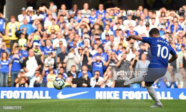Chelsea's Belgian midfielder Eden Hazard shoots from the penalty spot to score his team's third goal during the English Premier League football match...