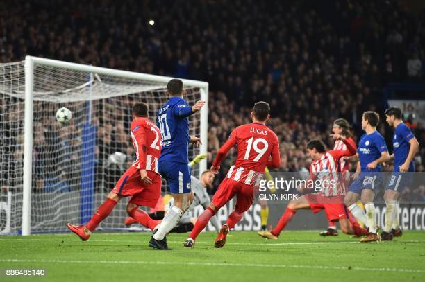 Chelsea's Belgian midfielder Eden Hazard shoots goalward and Atletico Madrid's Montenegrin defender Stefan Savic blocks to score an own goal during a...
