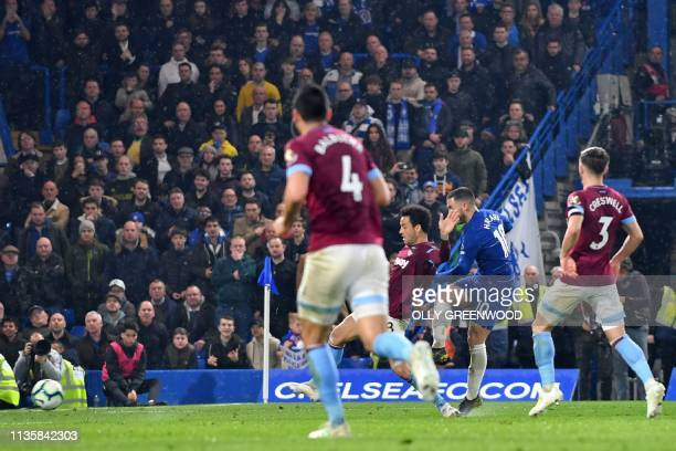 Chelsea's Belgian midfielder Eden Hazard shoots to score their second goal during the English Premier League football match between Chelsea and West...