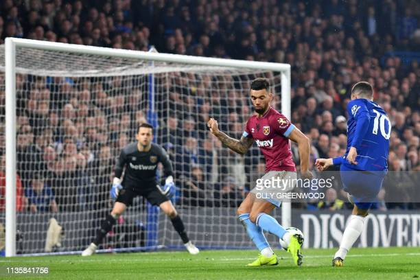 Chelsea's Belgian midfielder Eden Hazard shoots wide during the English Premier League football match between Chelsea and West Ham United at Stamford...