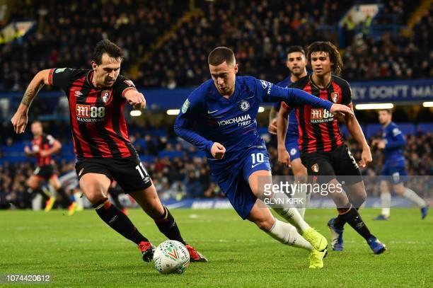 Chelsea's Belgian midfielder Eden Hazard takes on Bournemouth's Dutch defender Nathan Ake and Bournemouth's English midfielder Charlie Daniels during...