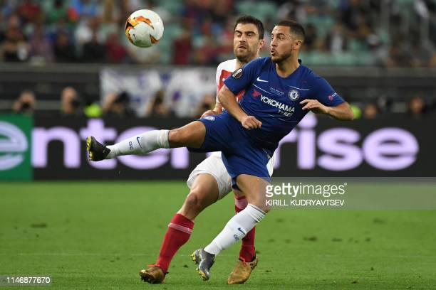 Chelsea's Belgian midfielder Eden Hazard vies for the ball with Arsenal's Greek defender Sokratis Papastathopoulos during the UEFA Europa League...