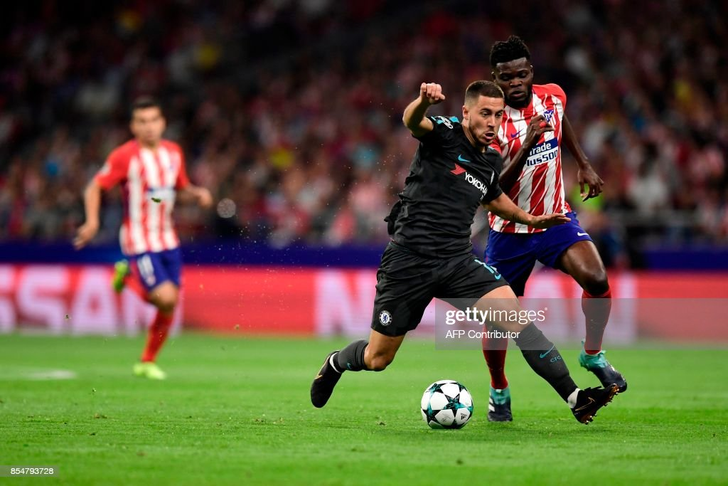 Chelsea's Belgian midfielder Eden Hazard (L) vies with Atletico Madrid's Ghanaian midfielder Thomas during the UEFA Champions League Group C football match Club Atletico de Madrid vs Chelsea FC at the Metropolitan stadium in Madrid on September 27, 2017. /
