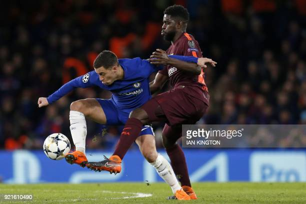 TOPSHOT Chelsea's Belgian midfielder Eden Hazard vies with Barcelona's French defender Samuel Umtiti during the first leg of the UEFA Champions...