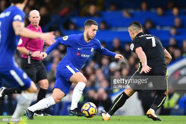 Chelsea's Belgian midfielder Eden Hazard vies with Brighton's Israeli midfielder Beram Kayal during the English Premier League football match between...