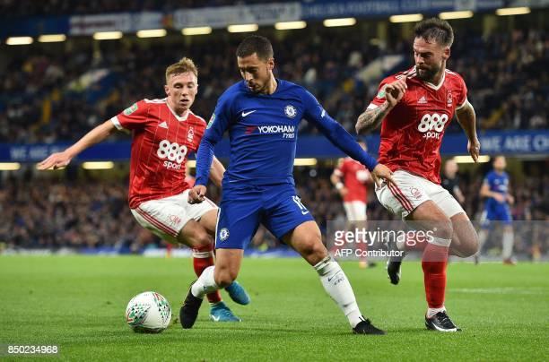 Chelsea's Belgian midfielder Eden Hazard vies with Burton Albion's English midfielder Tom Naylor during the English League Cup third round football...