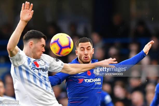 Chelsea's Belgian midfielder Eden Hazard vies with Everton's English defender Michael Keane during the English Premier League football match between...