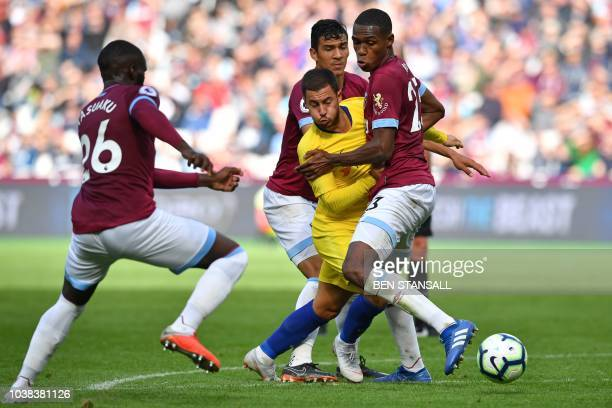 TOPSHOT Chelsea's Belgian midfielder Eden Hazard vies with West Ham United's French defender Arthur Masuaku West Ham United's Paraguayan defender...