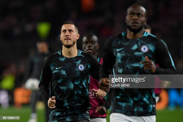 Chelsea's Belgian midfielder Eden Hazard warms up with teammates ahead of the UEFA Champions League round of sixteen second leg football match...