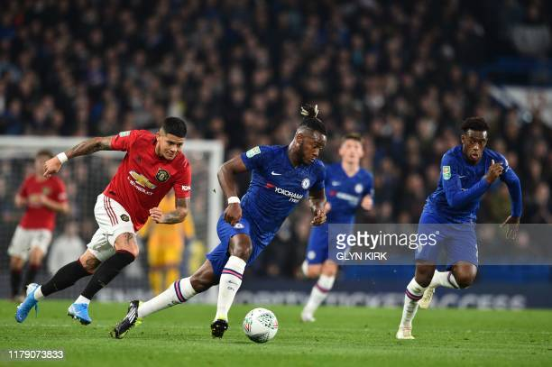 Chelsea's Belgian striker Michy Batshuayi C controls the ball during the English League Cup fourth round football match between Chelsea and...