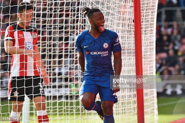 Chelsea's Belgian striker Michy Batshuayi celebrates after scoring their fourth goal during the English Premier League football match between...