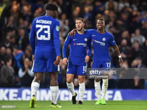Chelsea's Belgian striker Michy Batshuayi celebrates scoring his second and the team's fourth goal with Chelsea's Belgian midfielder Eden Hazard and...