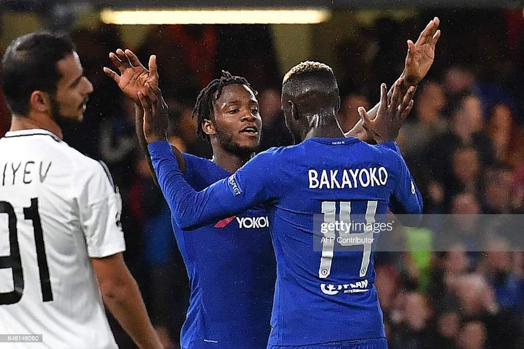 Chelsea's Belgian striker Michy Batshuayi celebrates scoring his team's fifth goal with Chelsea's French midfielder Tiemoue Bakayoko during the UEFA Champions League Group C football match between Chelsea and Qarabag at Stamford Bridge in London on September 12, 2017. / AFP PHOTO / Ben STANSALL