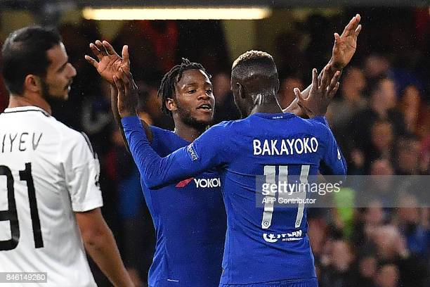 Chelsea's Belgian striker Michy Batshuayi celebrates scoring his team's fifth goal with Chelsea's French midfielder Tiemoue Bakayoko during the UEFA...