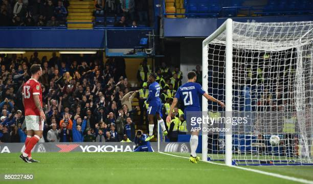 Chelsea's Belgian striker Michy Batshuayi celebrates scoring his team's second goal during the English League Cup third round football match between...