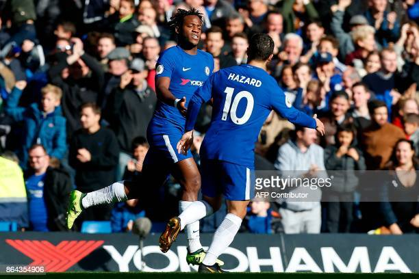 Chelsea's Belgian striker Michy Batshuayi celebrates scoring his team's second goal with Chelsea's Belgian midfielder Eden Hazard during the English...
