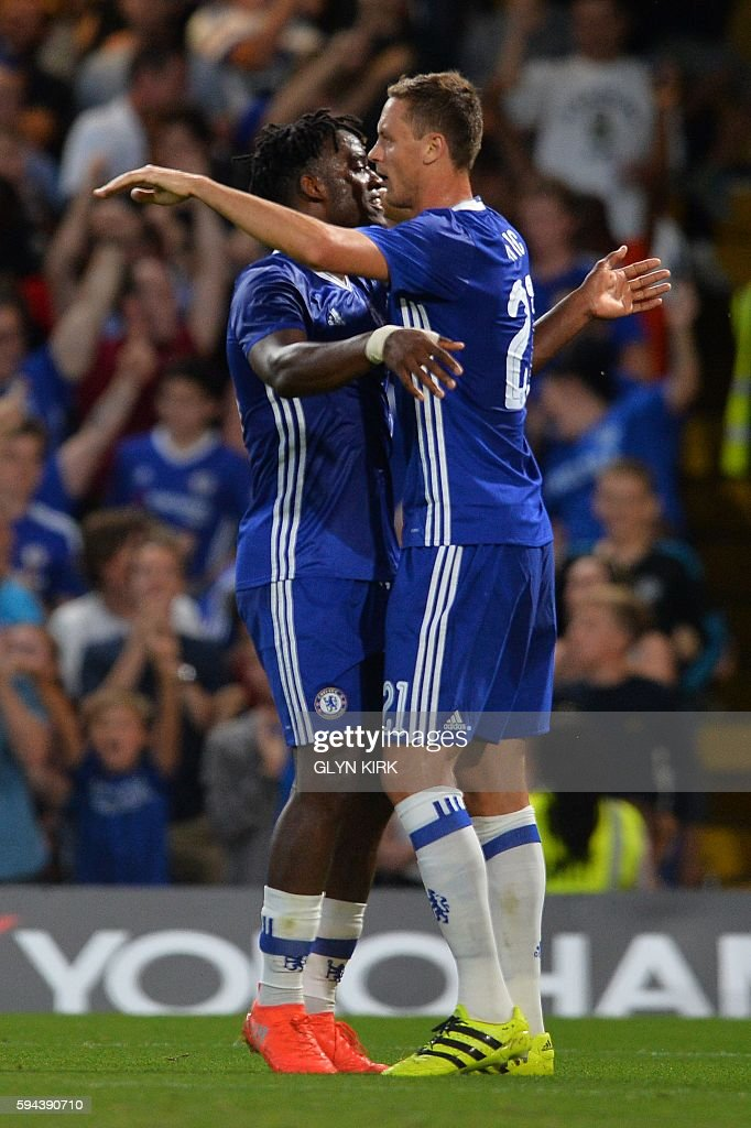 Chelsea's Belgian striker Michy Batshuayi (L) celebrates scoring the opening goal with Chelsea's Serbian midfielder Nemanja Matic (R) during the English League Cup second round football match between Chelsea and Bristol Rovers at Stamford Bridge in London on August 23, 2016. / AFP / GLYN KIRK / RESTRICTED TO EDITORIAL USE. No use with unauthorized audio, video, data, fixture lists, club/league logos or 'live' services. Online in-match use limited to 75 images, no video emulation. No use in betting, games or single club/league/player publications. /