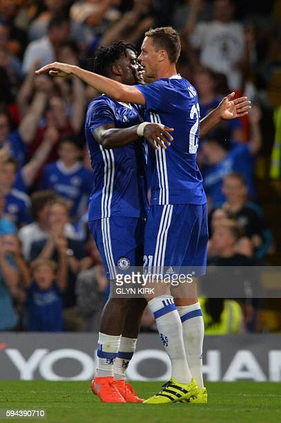 Chelsea's Belgian striker Michy Batshuayi celebrates scoring the opening goal with Chelsea's Serbian midfielder Nemanja Matic during the English...