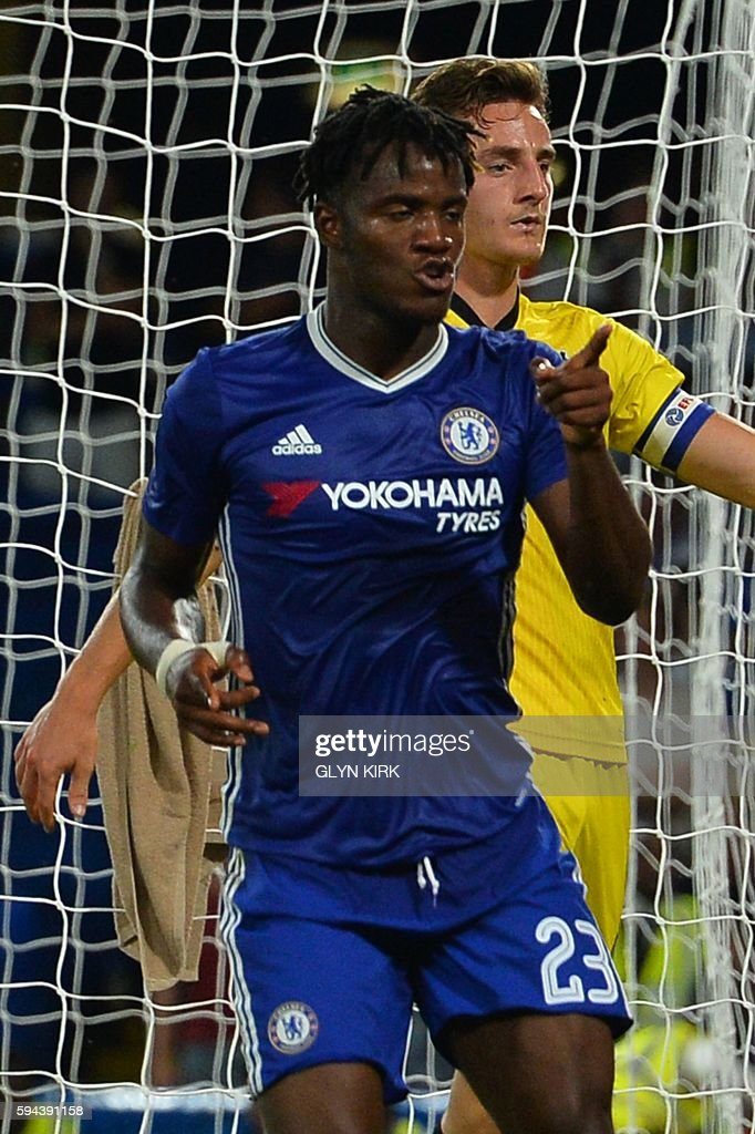 Chelsea's Belgian striker Michy Batshuayi celebrates scoring their third goal during the English League Cup second round football match between Chelsea and Bristol Rovers at Stamford Bridge in London on August 23, 2016. / AFP / GLYN KIRK / RESTRICTED TO EDITORIAL USE. No use with unauthorized audio, video, data, fixture lists, club/league logos or 'live' services. Online in-match use limited to 75 images, no video emulation. No use in betting, games or single club/league/player publications. /