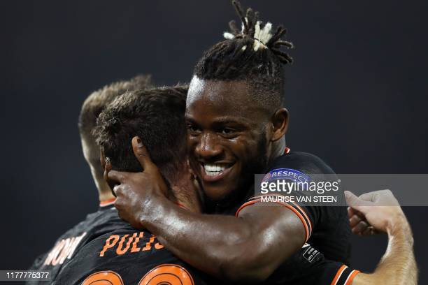 Chelsea's Belgian striker Michy Batshuayi celebrates with teammates after scoring a goal during the UEFA Champions League Group H football match...