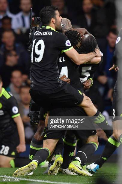 Chelsea's Belgian striker Michy Batshuayi celebrates with teammates scorintg the opening goal during the English Premier League match between West...
