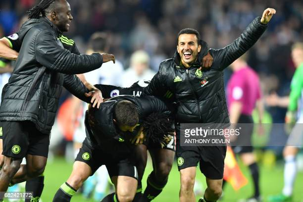 Chelsea's Belgian striker Michy Batshuayi celebrates with teammates scoring the opening goal during the English Premier League match between West...