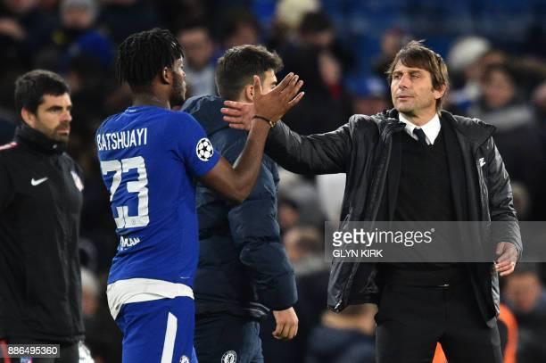 Chelsea's Belgian striker Michy Batshuayi greets Chelsea's Italian head coach Antonio Conte after a UEFA Champions League Group C football match...