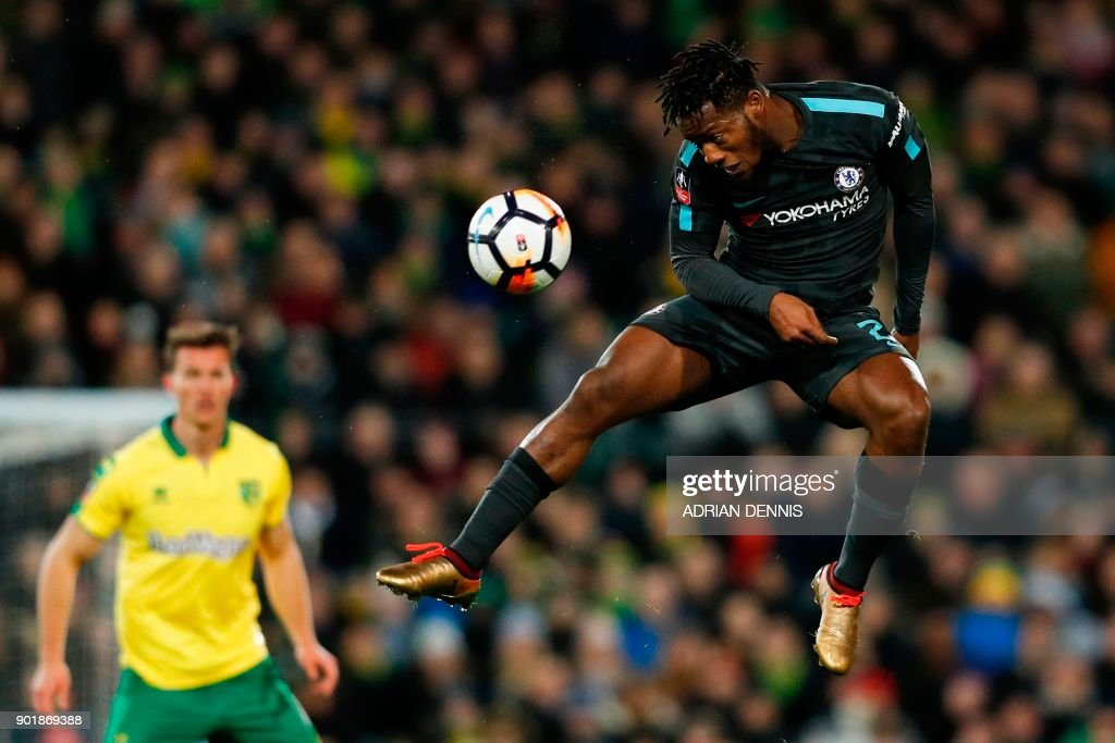 TOPSHOT - Chelsea's Belgian striker Michy Batshuayi heads the ball during the English FA Cup third round football match between Norwich City and Chelsea at Carrow Road in Norwich, north east England on January 6, 2018. / AFP PHOTO / Adrian DENNIS / RESTRICTED TO EDITORIAL USE. No use with unauthorized audio, video, data, fixture lists, club/league logos or 'live' services. Online in-match use limited to 75 images, no video emulation. No use in betting, games or single club/league/player publications. /