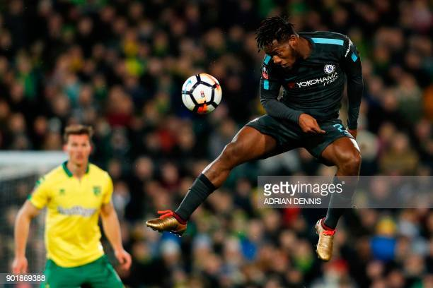 TOPSHOT Chelsea's Belgian striker Michy Batshuayi heads the ball during the English FA Cup third round football match between Norwich City and...