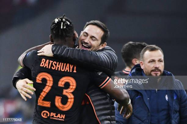 Chelsea's Belgian striker Michy Batshuayi is congratulated by Chelsea's English head coach Frank Lampard at the end of the UEFA Champions League...