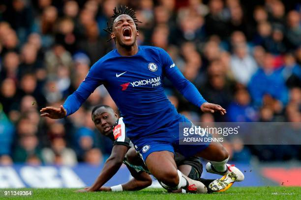 Chelsea's Belgian striker Michy Batshuayi is fouled by Newcastle United's Senegalese midfielder Henri Saivet during the English FA Cup fourth round...